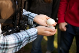 Students holding eggs