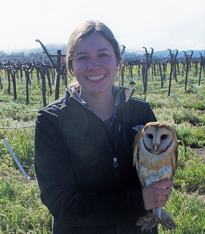 Allison Huysman - Holding an owl in a vineyard