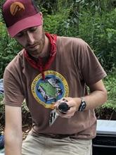 Deven Kammerichs-Berke - holding a small bird