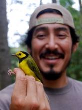 Xerónimo Castañeda - Holding a bird in the forest