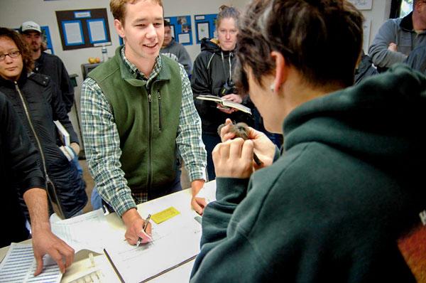 Students inside the Wright Refuge doing bird banding